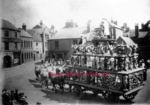 Probably Lord George Sanger's Britainia Wagon in Procession at Selby circa 1930. The photo fits with one at the NFA of the same time. Further information welcome.